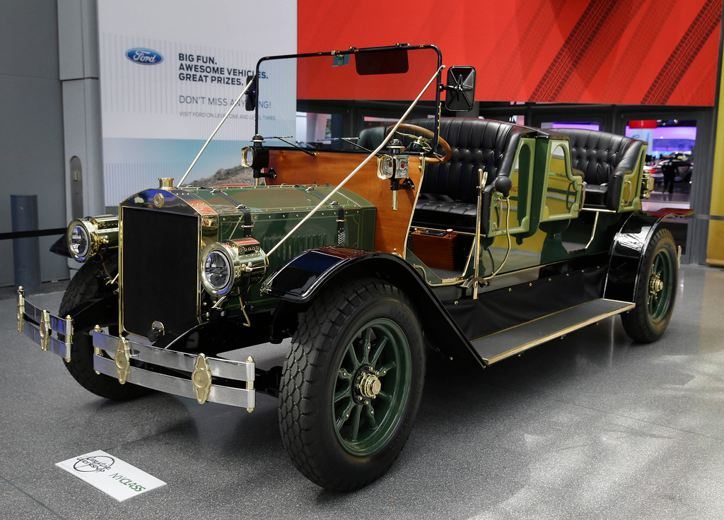 . A prototype of an electric carriage is displayed at the New York International Auto Show in New York, Thursday, April 17, 2014.  A prototype of the old-timey electric cars that Mayor Bill de Blasio would like to take the place of horse-drawn carriages on New York City streets will be unveiled at the New York Auto Show on Thursday. (AP Photo/Seth Wenig)