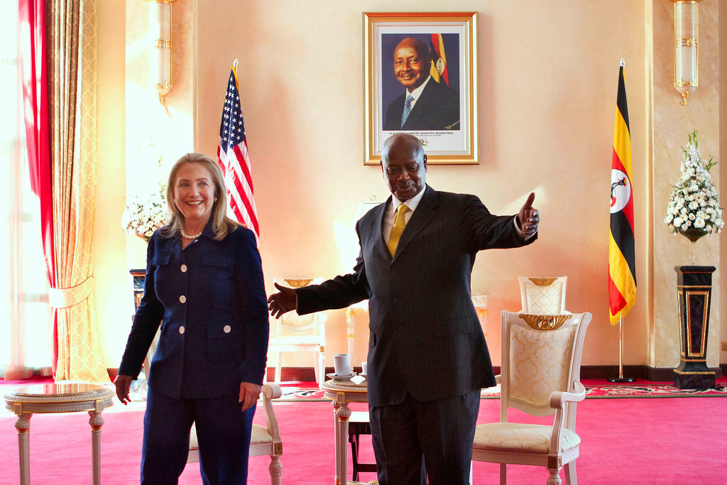 """. In this Friday, Aug. 3, 2012 file photo, Secretary of State Hillary Rodham Clinton, left, meets with Ugandan President Yoweri Museveni, right, at the State House in Kampala, Uganda. Ugandan President Yoweri Museveni met in his office with a team of U.S.-based rights activists concerned about legislation that would impose life sentences for some homosexual acts and made clear he had no plans to sign the bill, according to Santiago Canton of the Robert F. Kennedy Center for Justice and Human Rights who attended the Jan. 18, 2014 meeting, but one month later Museveni appears to have changed his mind, saying through a spokesman in February 2014 that he would sign the bill \""""to protect Ugandans from social deviants.\"""" (AP Photo/Jacquelyn Martin, Pool, File)"""
