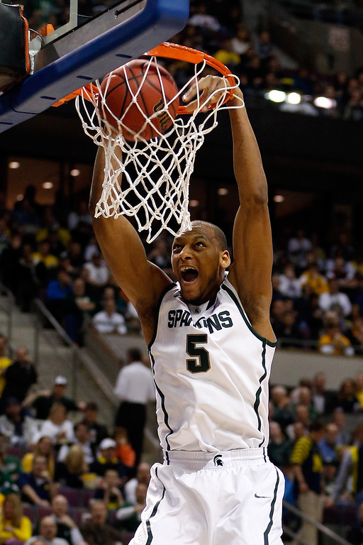 . AUBURN HILLS, MI - MARCH 23:  Adreian Payne #5 of the Michigan State Spartans dunks in the first half agianst the Memphis Tigers during the third round of the 2013 NCAA Men\'s Basketball Tournament at The Palace of Auburn Hills on March 23, 2013 in Auburn Hills, Michigan.  (Photo by Gregory Shamus/Getty Images)