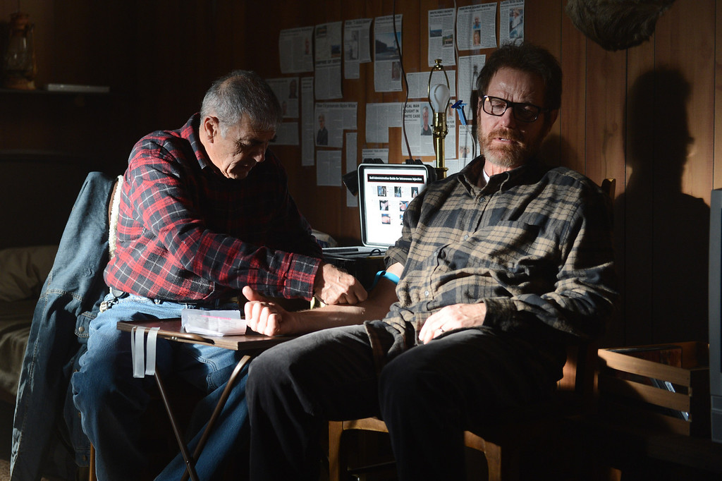 ". This image released by AMC shows Robert Forster, left, and Bryan Cranston in a scene from  ""Breaking Bad,\"" which aired on Sunday, Sept. 22. The Nielsen company said that on the same night that \""Breaking Bad\"" won an Emmy Award for best drama, the penultimate episode of that AMC series set a viewership record. An estimated 6.6 million people watched \""Breaking Bad\"" on Sunday, which was airing the same time the cast got its award.  (AP Photo/AMC, Ursula Coyote)"