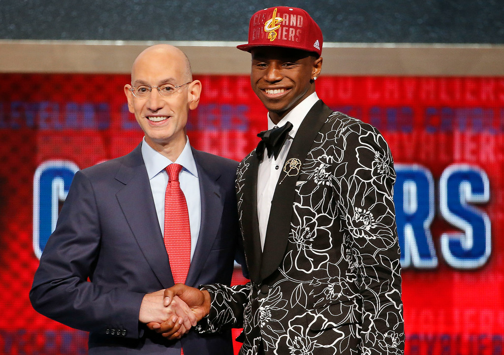. NBA Commissioner Adam Silver, left, congratulates Andrew Wiggins of Kansas who was selected by the Cleveland Cavaliers as the number one pick in the 2014 NBA draft, Thursday, June 26, 2014, in New York. (AP Photo/Jason DeCrow)