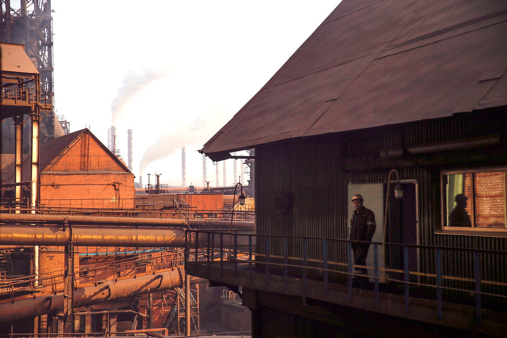 . An employee stands on the balcony of a rest area inside the Zaporizhstal steel plant, owned and operated by Metinvest BV, at their site in Zaporizhzhya, Ukraine, on Monday, Oct. 14, 2013. Metinvest BV, Ukraine\'s largest steelmaker, last year acquired 49.9% in steelmaker Zaporizhstal a manufacturer of semi-finished steel products, including hot and cold-rolled plates and coils. Photographer: Vincent Mundy/Bloomberg