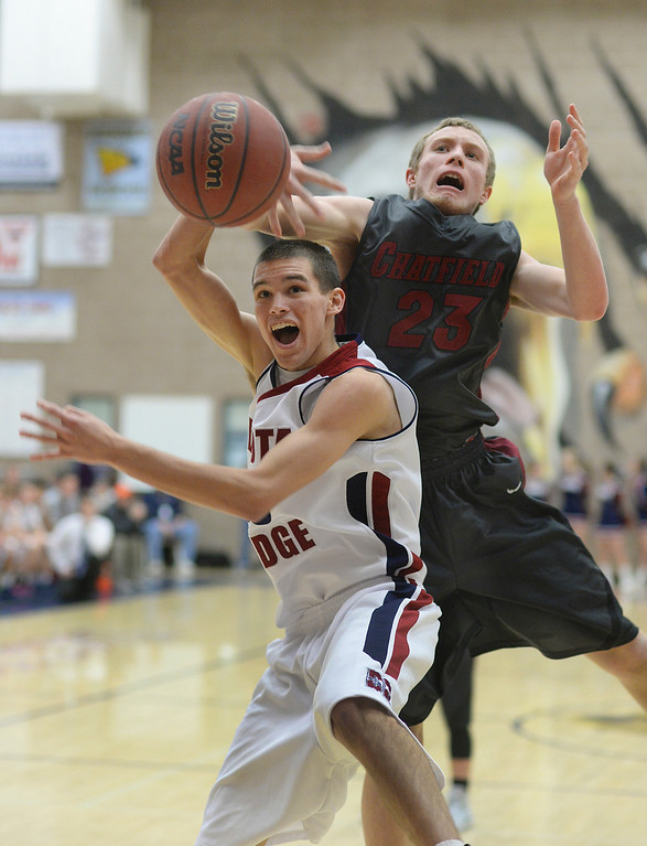 . LITTLETON, CO. - JANUARY 17:Eagles\' guard Cody Pittman (10) fought for a rebound with Chargers\' senior forward Grant Haines (23) in the second half. The Dakota Ridge High School boy\'s basketball team hung on to beat Chatfield 53-51 Friday night, January 17, 2014. Photo By Karl Gehring/The Denver Post
