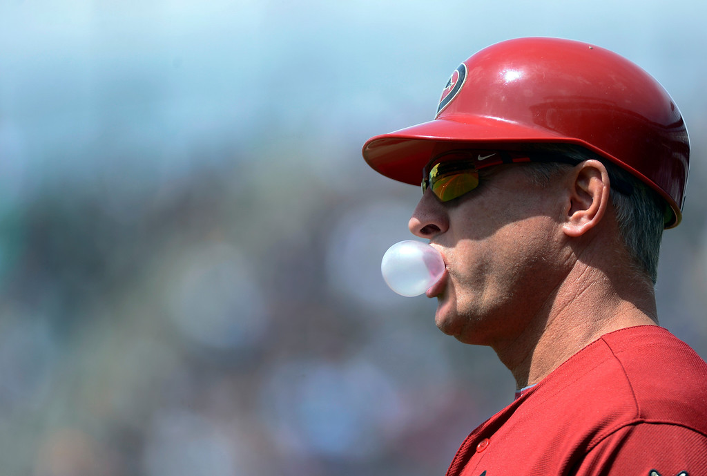 . DENVER, CO. - APRIL 21: Arizona DiamondBacks Steve Sax (5) blows a bubble during their game against the Colorado Rockies April 21, 2013 at Coors Field. (Photo By John Leyba/The Denver Post)