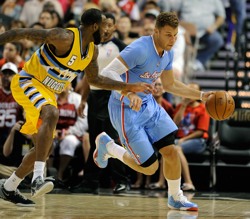 . Blake Griffin #32 of the Los Angeles Clippers brings the ball up the court against Damion James #5 of the Denver Nuggets during their preseason game at the Mandalay Bay Events Center on October 19, 2013 in Las Vegas, Nevada. Los Angeles won 118-111 in overtime.   (Photo by Ethan Miller/Getty Images)