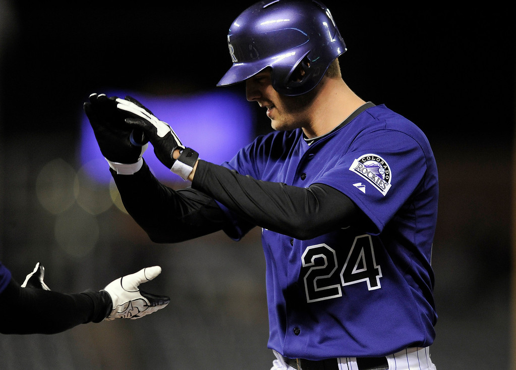 . Colorado Rockies Jordan Lyles celebrates after hitting a single in the fifth inning of a baseball game against the Chicago White Sox on Monday, April 7, 2014, in Denver. The Rockies won 8-1. (AP Photo/Chris Schneider)