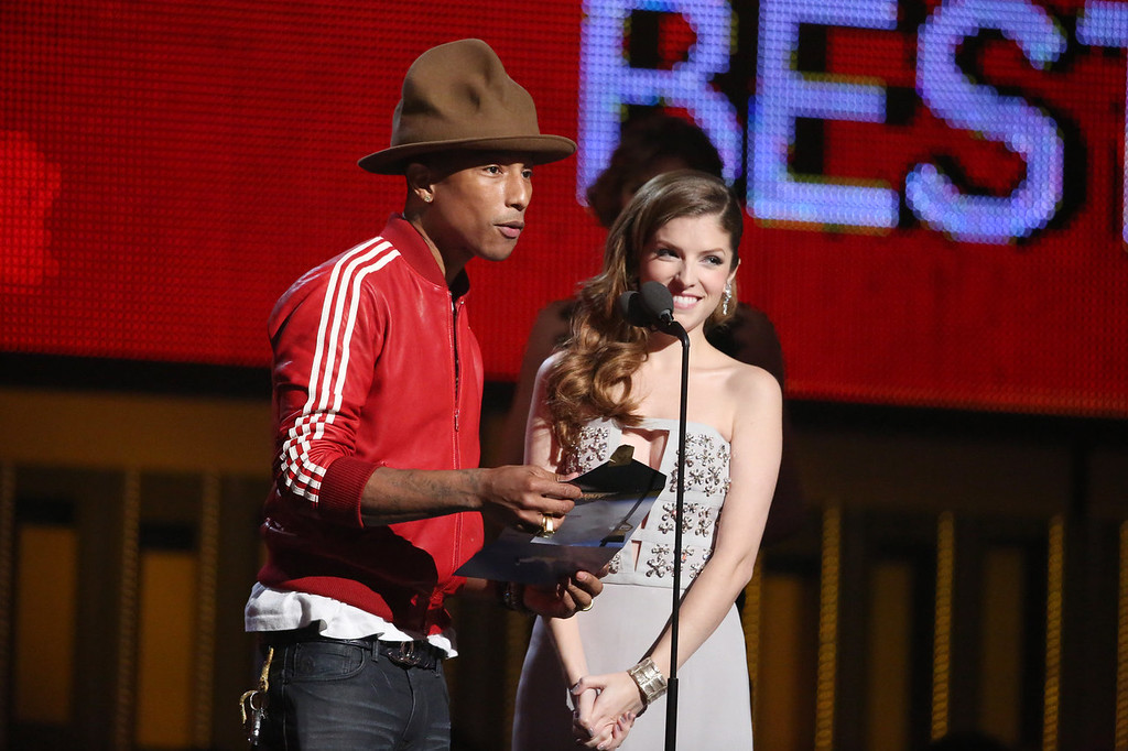 . Pharrell Williams, left, and Anna Kendrick present the award for best new artist at the 56th annual Grammy Awards at Staples Center on Sunday, Jan. 26, 2014, in Los Angeles. (Photo by Matt Sayles/Invision/AP)