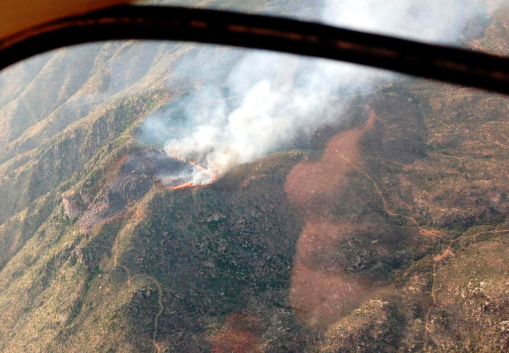 . An aerial view shows the Yarnell Hill fire burning near Yarnell, Arizona, in this Arizona State Forestry Division handout photo taken June 29, 2013. Nineteen elite firefighters from  Granite Mountain Hotshots were killed in a raging Arizona wildfire stoked by record heat and high winds, marking the greatest loss of life among firefighters from a single U.S. wildland blaze in 80 years. The Prescott, Arizona, Fire Department crew was killed on Sunday when a fast-moving wildfire they were battling trapped them near Yarnell, a town about 80 miles (128 km) northwest of Phoenix. Picture taken June 9, 2013.  REUTERS/Arizona State Forestry Division/Handout