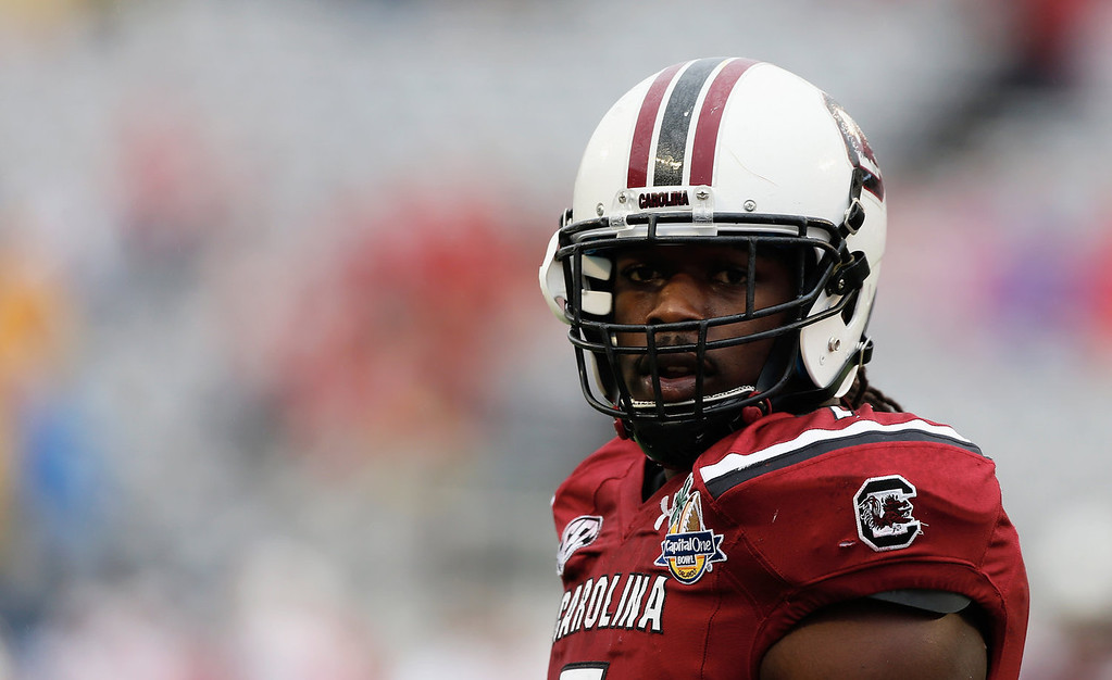 . Jadeveon Clowney #7 of the South Carolina Gamecocks works out on the field before the start of their game against the Wisconsin Badgers at the Capital One Bowl on January 1, 2014 in Orlando, Florida.  (Photo by Scott Halleran/Getty Images)