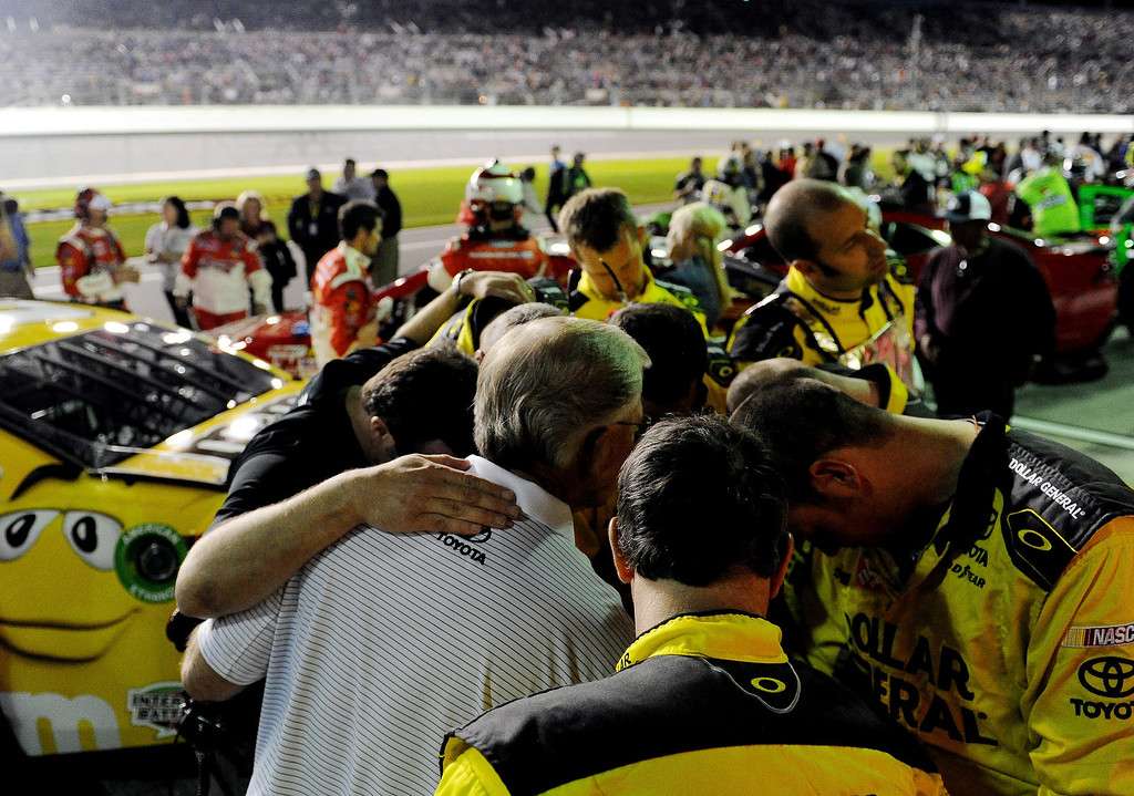 . Team owner Joe Gibbs (white shirt) huddles with crew members prior to the NASCAR Sprint Cup Series Budweiser Duel 1 at Daytona International Speedway on February 20, 2014 in Daytona Beach, Florida.  (Photo by Patrick Smith/Getty Images)