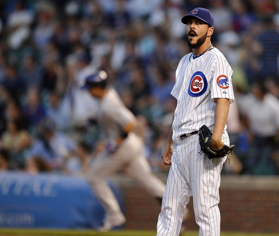 . Starting pitcher Carlos Villanueva #33 of the Chicago Cubs stands on the mound as Carlos Gonzalez #5 of the Colorado Rockies rounds the bases after hitting a solo home run during the third inning on May 14, 2013 at Wrigley Field in Chicago, Illinois.    (Photo by Brian Kersey/Getty Images)