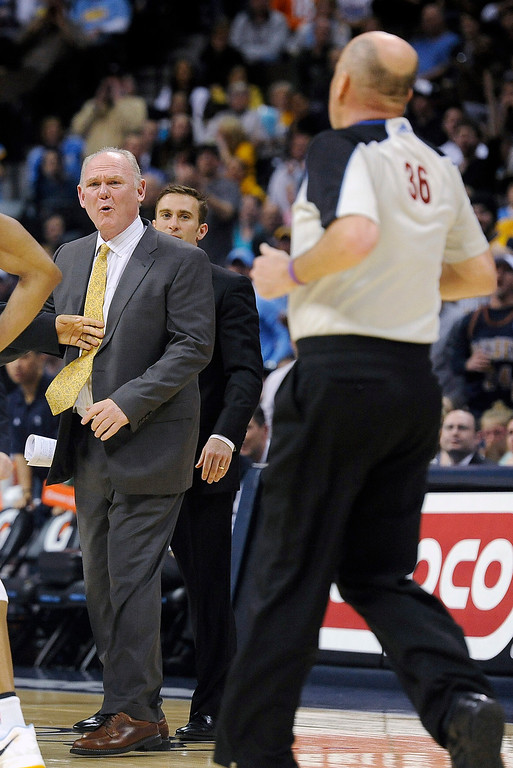 . Denver Nuggets coach George Karl yells at the referees after they called a foul on the Nuggets in the second half of an NBA basketball game against the Minnesota Timberwolves on Saturday, March 9, 2013, in Denver.  (AP Photo/Chris Schneider)