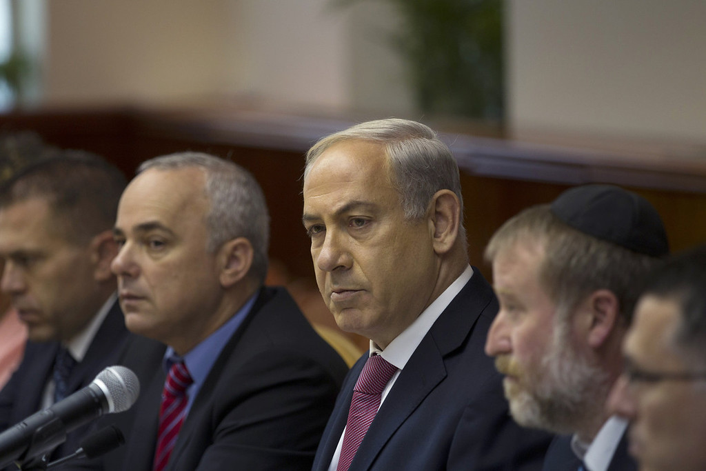 . Israel\'s Prime Minister Benjamin Netanyahu (C) attends the weekly cabinet meeting in Jerusalem July 28, 2013. Netanyahu urged his rightist cabinet to approve a divisive Israeli decision to release 104 Arab prisoners in order to restart peace talk with the Palestinians.  RONEN ZVULUN/AFP/Getty Images