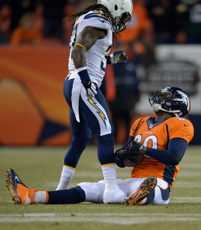 . Denver Broncos tight end Julius Thomas (80) reacts to his catch during the first drive of the game as San Diego Chargers defensive back Jahleel Addae (37) looks on. The Denver Broncos vs. the San Diego Chargers at Sports Authority Field at Mile High in Denver on December 12, 2013. (Photo by Joe Amon/The Denver Post)