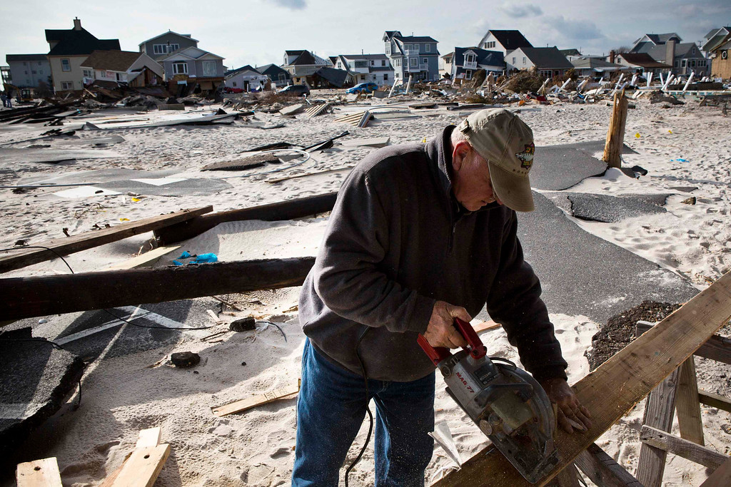 . Paul Lynch, a contractor, cuts lumber while repairing a home he built 23 years ago that was damaged by Hurricane Sandy, in the Ortley Beach area of Toms River, New Jersey November 28, 2012. The storm made landfall along the New Jersey coastline on October 29, 2012 - one month ago tomorrow. REUTERS/Andrew Burton