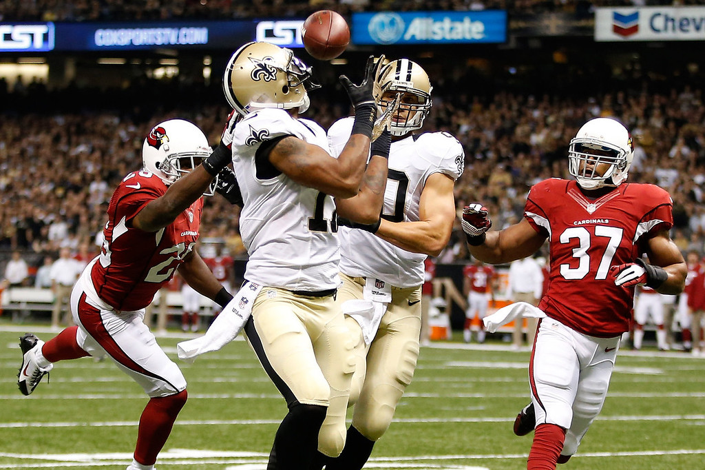 . NEW ORLEANS, LA - SEPTEMBER 22:  Robert Meachem #17 of the New Orleans Saints catches a touchdown pass over  Jerraud Powers #25 of the Arizona Cardinals at the Mercedes-Benz Superdome on September 22, 2013 in New Orleans, Louisiana.  (Photo by Chris Graythen/Getty Images)