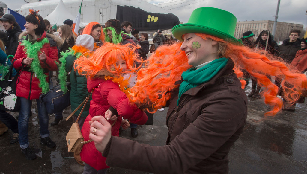 . People dance during a St. Patrick\'s Day Parade in Moscow, Russia, Saturday, March 16, 2013. (AP Photo/Misha Japaridze)
