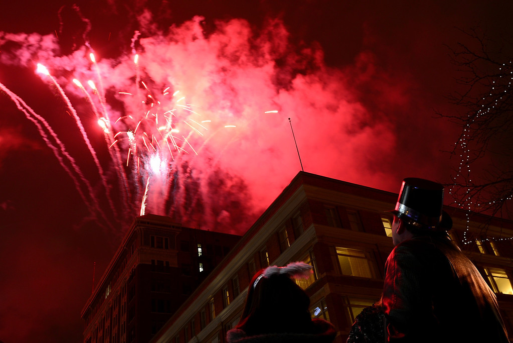 . People watch fireworks on the 16th Street Mall on Monday, December 31, 2012. AAron Ontiveroz/The Denver Post