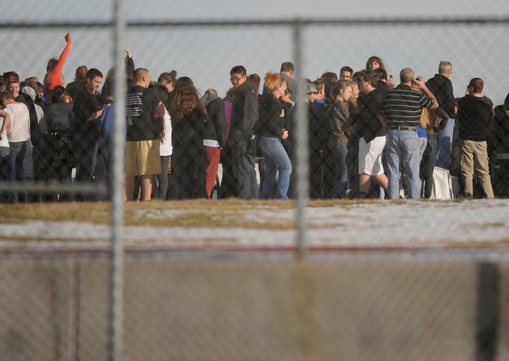 . CENTENNIAL, CO. - DECEMBER 13: Students tried to use cell phones to contact loved ones outside Arapahoe High School Friday afternoon. Parents had to wait hours to be reunited with their children Friday afternoon, December 13, 2013. A shooting inside the school sent hundreds of students rushing for safety. Photo By Karl Gehring/The Denver Post