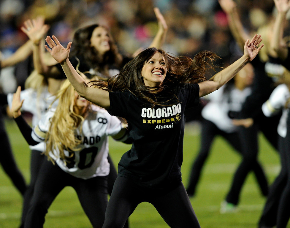 . BOULDER, CO. - OCTOBER 26: Alumni members of the CU dance team showed they still have during a performance in the second half. The University of Colorado football team hosted Arizona Saturday night, October 26, 2013. Photo By Karl Gehring/The Denver Post
