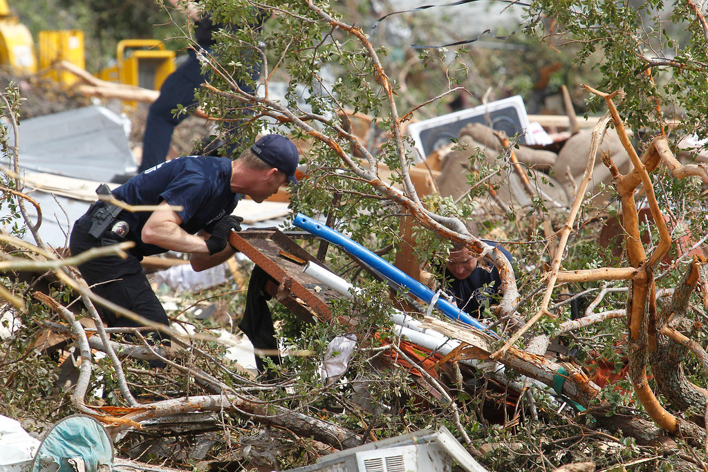 . Crushed autos sit amid the rubble of destroyed homes as emergency personnel continue search efforts to locate unaccounted for people in the Rancho Brazos neighborhood in Granbury, Texas, Thursday, May 16, 2013.    (AP Photo/The Fort Worth Star-Telegram, Paul Moseley)