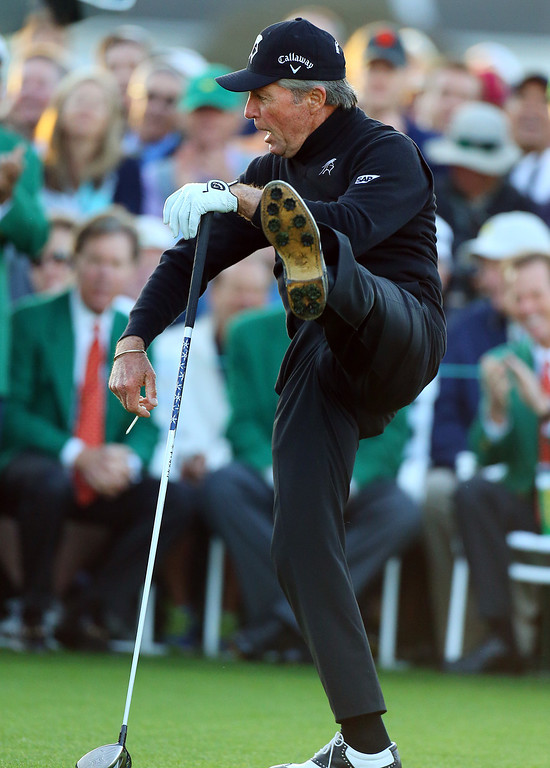 . Gary Player kicks his leg up after hitting his ceremonial drive on the first tee during the first round of the Masters golf tournament Thursday, April 10, 2014, in Augusta, Ga. (AP Photo/Atlanta Journal-Constitution, Curtis compton)