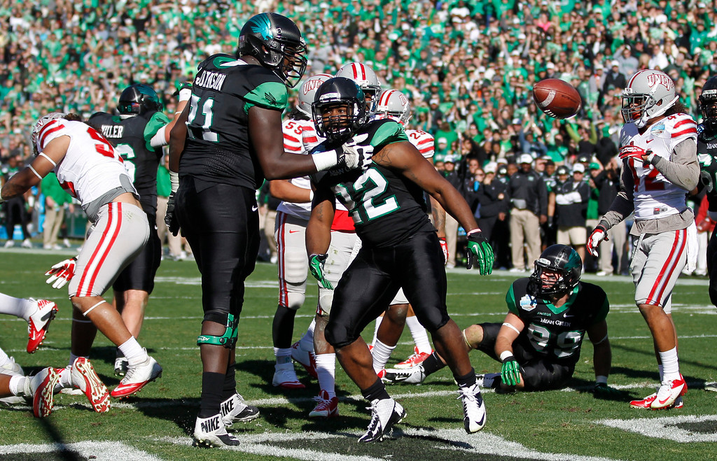 . North Texas running back Antoinne Jimmerson (22) and offensive lineman Antonio Johnson (71) celebrate Jimmerson\'s touchdown against UNLV during the first half of the Heart of Dallas NCAA college football game, Wednesday, Jan. 1, 2014, in Dallas. (AP Photo/Mike Stone)