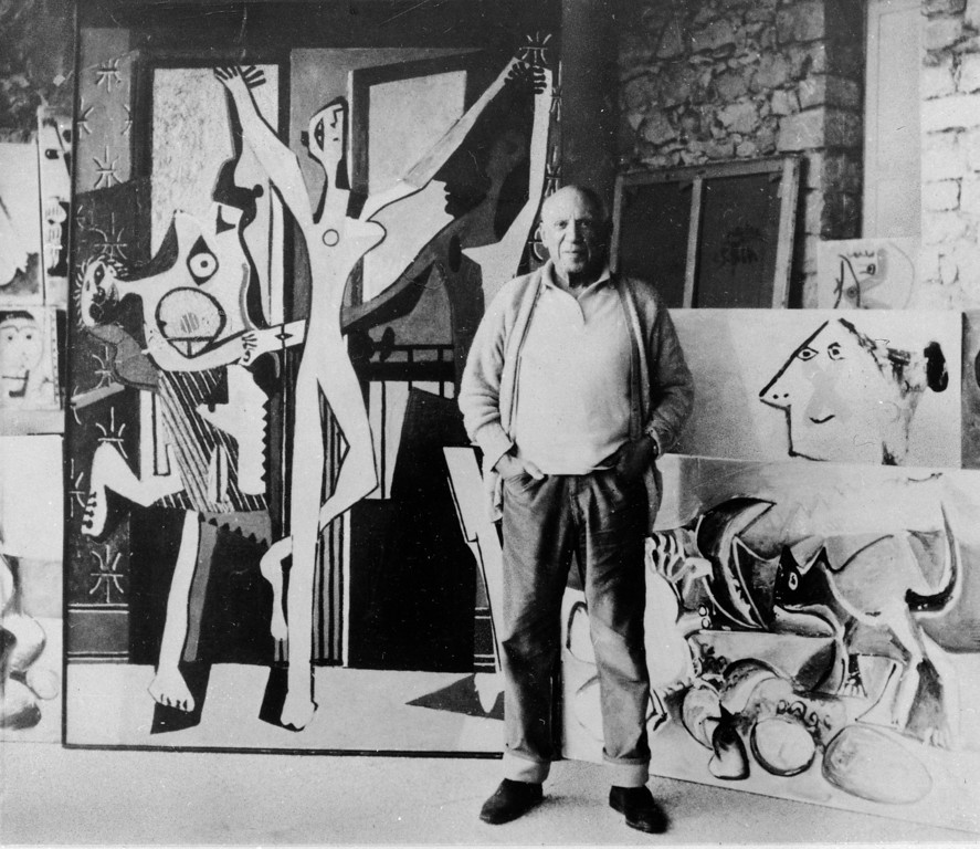 ". Artist Pablo Picasso poses in 1965 in front of one of his favorite paintings, ""Les Trois Danseur,\"" (The Three Dancers), at left, which the Spanish-born artist kept for 40 years before selling it to a London gallery.  (AP Photo)"