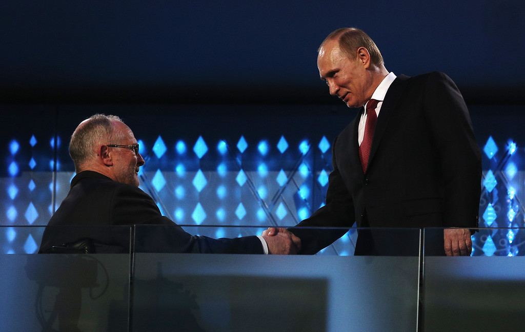 . Russia President Vladimir Putin (R) shakes hands with International Paralympic Committee (IPC) President Sir Philip Craven during the Sochi 2014 Paralympic Winter Games Closing Ceremony at Fisht Olympic Stadium on March 16, 2014 in Sochi, Russia.  (Photo by Hannah Peters/Getty Images)