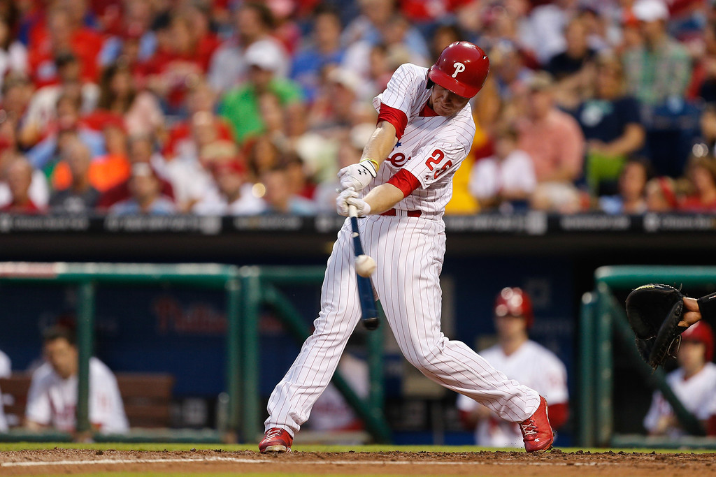 . PHILADELPHIA, PA - AUGUST 22: Cody Asche #25 of the Philadelphia Phillies hits an RBI double in the second inning of the game against the Colorado Rockies  at Citizens Bank Park on August 22, 2013 in Philadelphia, Pennsylvania. (Photo by Brian Garfinkel/Getty Images)