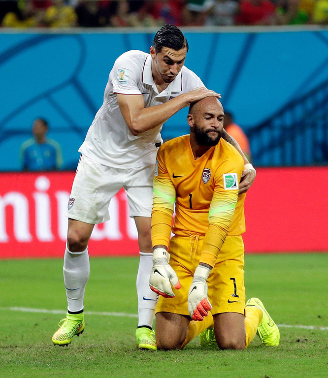 . United States\' Geoff Cameron pats United States\' goalkeeper Tim Howard on the head after Howard made a save during the group G World Cup soccer match between the United States and Portugal at the Arena da Amazonia in Manaus, Brazil, Sunday, June 22, 2014. (AP Photo/Julio Cortez)