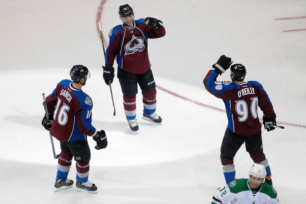 . Colorado Avalanche defenseman Andre Benoit (61) celebrates his goal with teammates defenseman Cory Sarich (16) and center Ryan O\'Reilly (90) agains the Dallas Stars during the second period. (Photo by AAron Ontiveroz/The Denver Post)