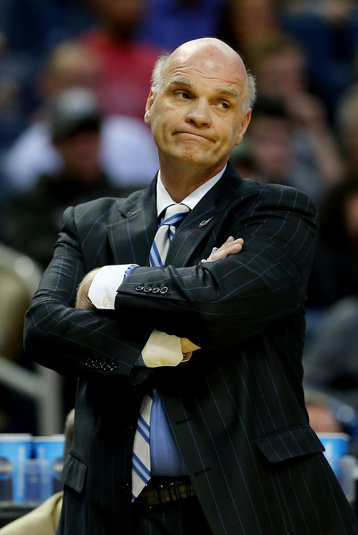 . BUFFALO, NY - MARCH 20: Head coach Phil Martelli of the Saint Joseph\'s Hawks reacts during the second round of the 2014 NCAA Men\'s Basketball Tournament against the Connecticut Huskies at the First Niagara Center on March 20, 2014 in Buffalo, New York.  (Photo by Elsa/Getty Images)