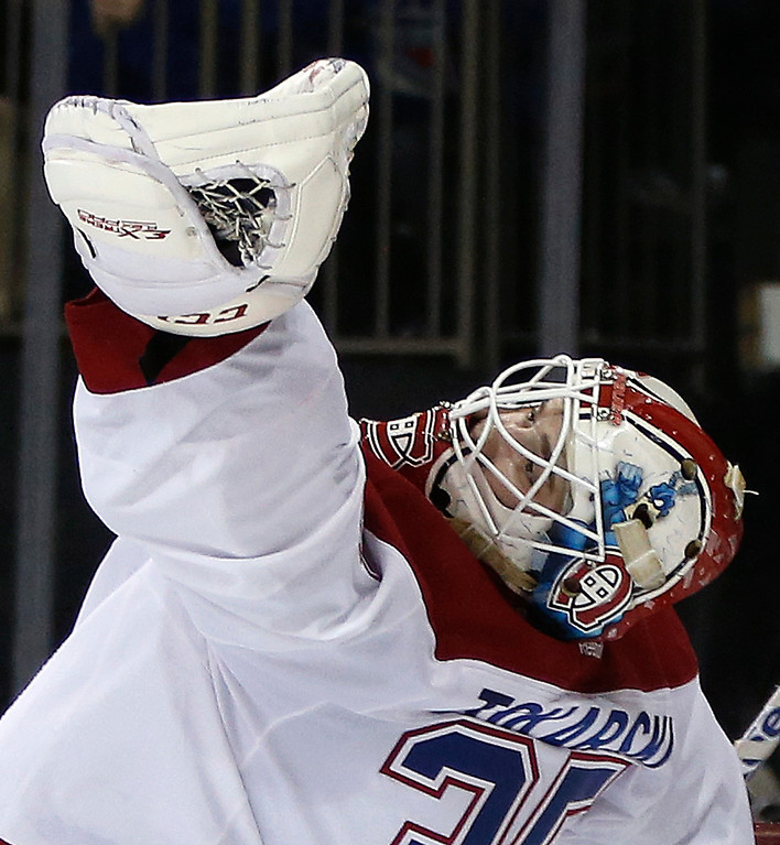 . Montreal Canadiens goalie Dustin Tokarski (35) grabs a shot  by the New York Rangers in his glove during the second period  in Game 6 of the NHL hockey Stanley Cup playoffs Eastern Conference finals, Thursday, May 29, 2014, in New York. (AP Photo/Kathy Willens)