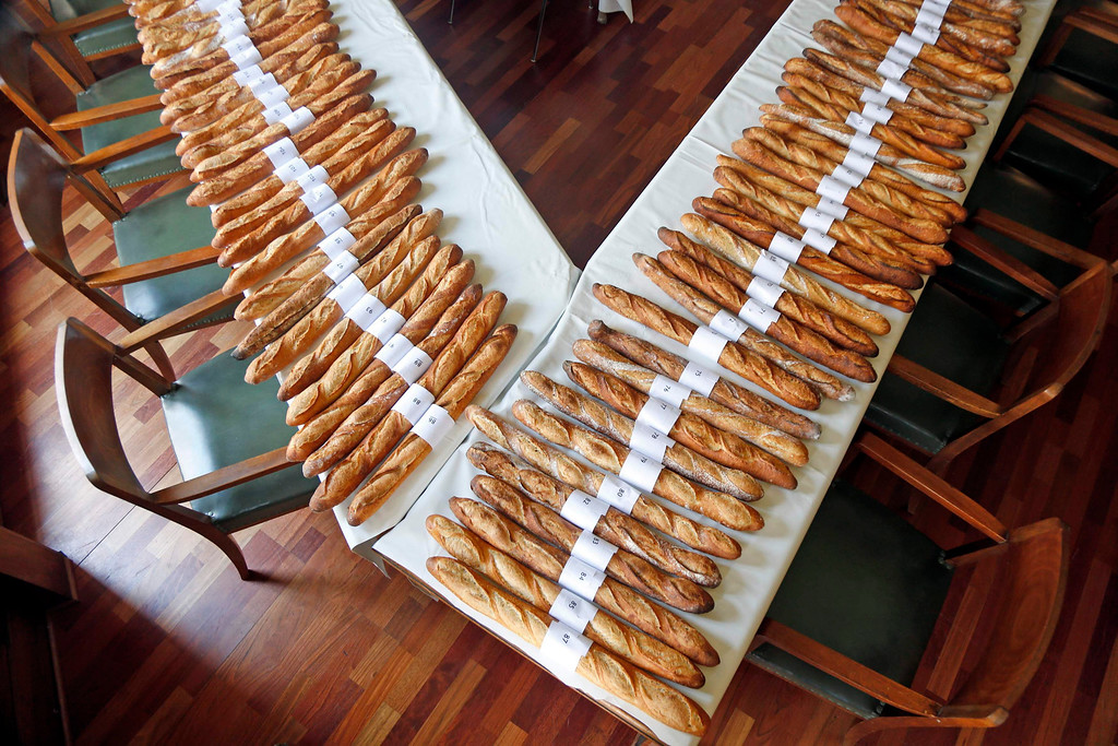 . Baguettes, French bread, selected in the competition for the \'Grand Prix de la Baguette de la Ville de Paris\' (Best Baguette of Paris 2013) are displayed on tables at the annual prize at the Chambre Professionnelle des Artisans Boulangers Patissiers in Paris April 25, 2013. The baguette is a French cultural symbol par excellence and the competition saw 203 Parisian bakers who compete for recognition as finest purveyor of one of France\'s most iconic staples. The baguettes are registered, given anonymous white wrappings and an identification number. They are then carefully weighed and measured to ensure they do not violate the contest\'s strict rules. 52 entries were withdrawn for failing to measure between 55-70cm long or not matching the acceptable weight of between 250-300g. Every year, the winner earns the privilege of baking bread for the French President.   REUTERS/Charles Platiau