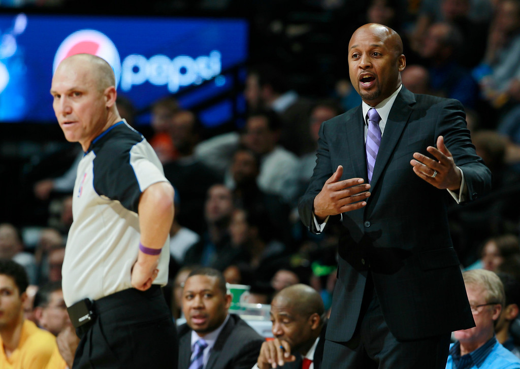 . Referee Ron Garretson, left, turns away as Denver Nuggets head coach Brian Shaw argues for a call against the Golden State Warriors in the fourth quarter of the Warriors\' 89-81 victory in an NBA basketball game in Denver on Monday, Dec. 23, 2013. (AP Photo/David Zalubowski)