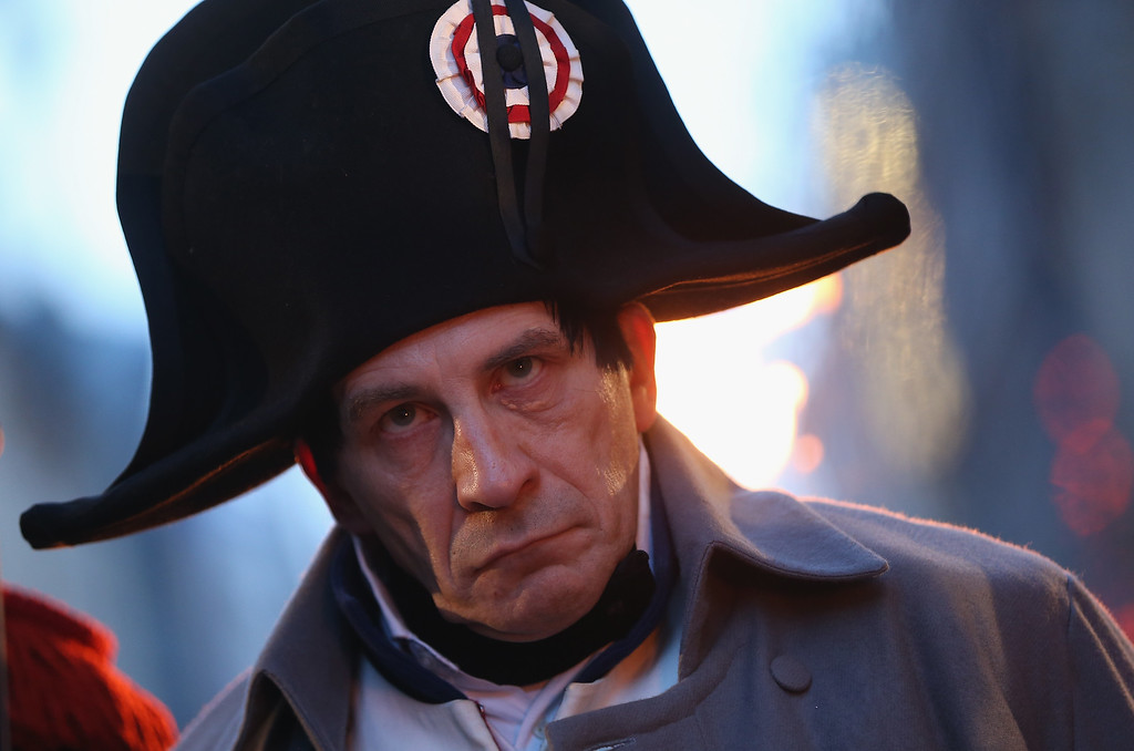 . An actor in the role of Napoleon Bonaparte watches the arrival of a Saxon Guard at the evening opening ceremony to commemorate the 200th anniversary of The Battle of Nations on October 16, 2013 in Leipzig, Germany.  (Photo by Sean Gallup/Getty Images)