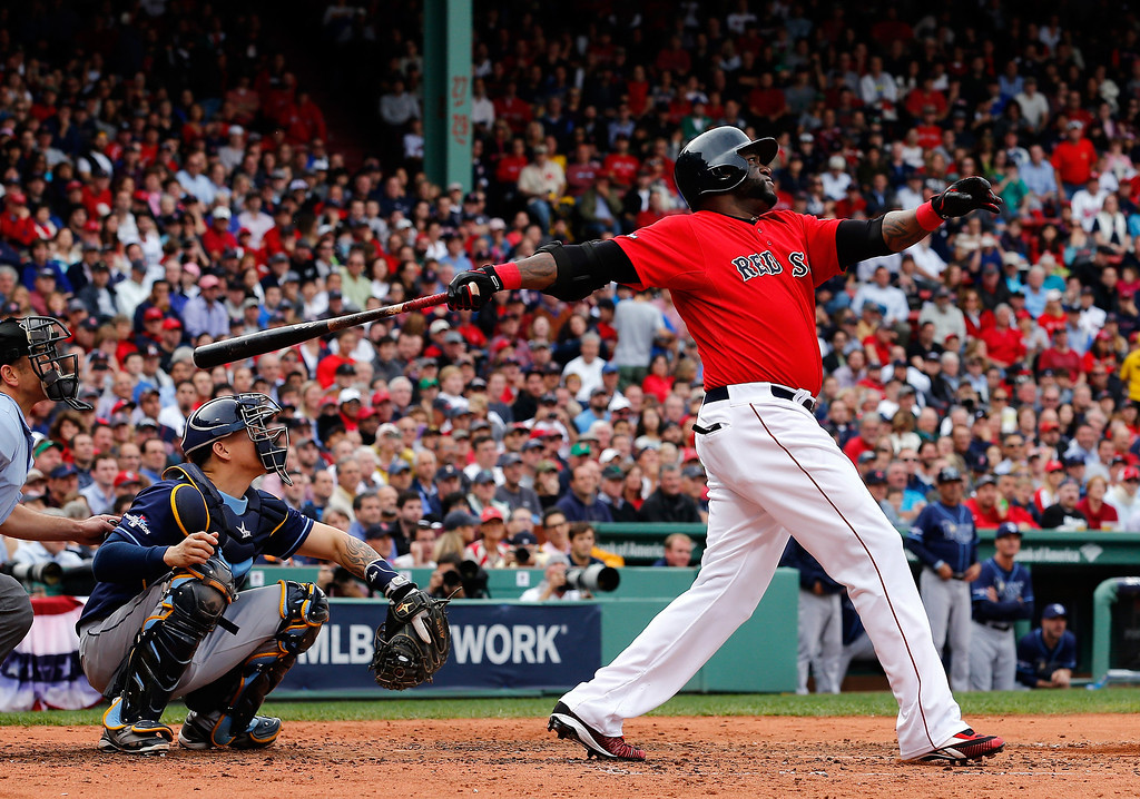 . David Ortiz #34 of the Boston Red Sox hits a ground rule double against the Tampa Bay Rays in the fouth inning of Game One of the American League Division Series at Fenway Park on October 4, 2013 in Boston, Massachusetts.  (Photo by Jim Rogash/Getty Images)