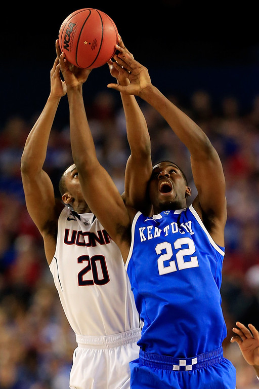 . ARLINGTON, TX - APRIL 07: Lasan Kromah #20 of the Connecticut Huskies and Alex Poythress #22 of the Kentucky Wildcats battle for a rebound during the NCAA Men\'s Final Four Championship at AT&T Stadium on April 7, 2014 in Arlington, Texas.  (Photo by Jamie Squire/Getty Images)