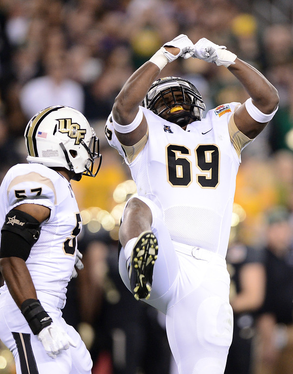 . GLENDALE, AZ - JANUARY 01:  Defensive lineman Thomas Niles #69 of the UCF Knights celebrates after sacking quarterback Bryce Petty #14 of the Baylor Bears during the Tostitos Fiesta Bowl at University of Phoenix Stadium on January 1, 2014 in Glendale, Arizona.  (Photo by Jennifer Stewart/Getty Images)
