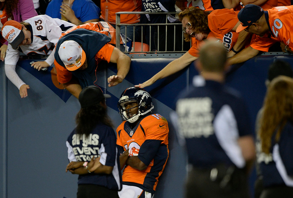 . DENVER, CO - AUGUST 23: Denver Broncos wide receiver Emmanuel Sanders (10) soaks it in after his  touchdown catch against Houston Texans defensive back Eddie Pleasant (35) during the second quarter August 23, 2014 at Sports Authority Field at Mile High Stadium. (Photo by John Leyba/The Denver Post)