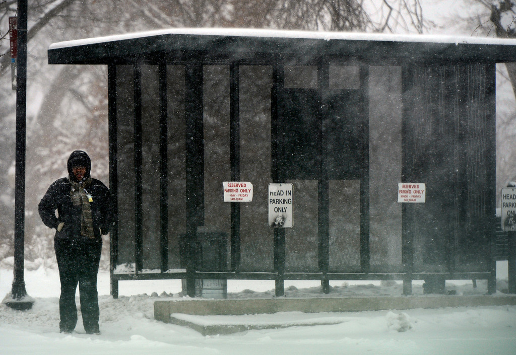 . LITTLETON, CO. - MARCH 23:  Sholonda Jones waits for a bus at the RTD station in downtown Littleton, CO March 23, 2013. The Saturday forecast calls for snow accumulation of 9 to 12 inches with highs in the lower to mid 20s. (Photo By Craig F. Walker/The Denver Post)