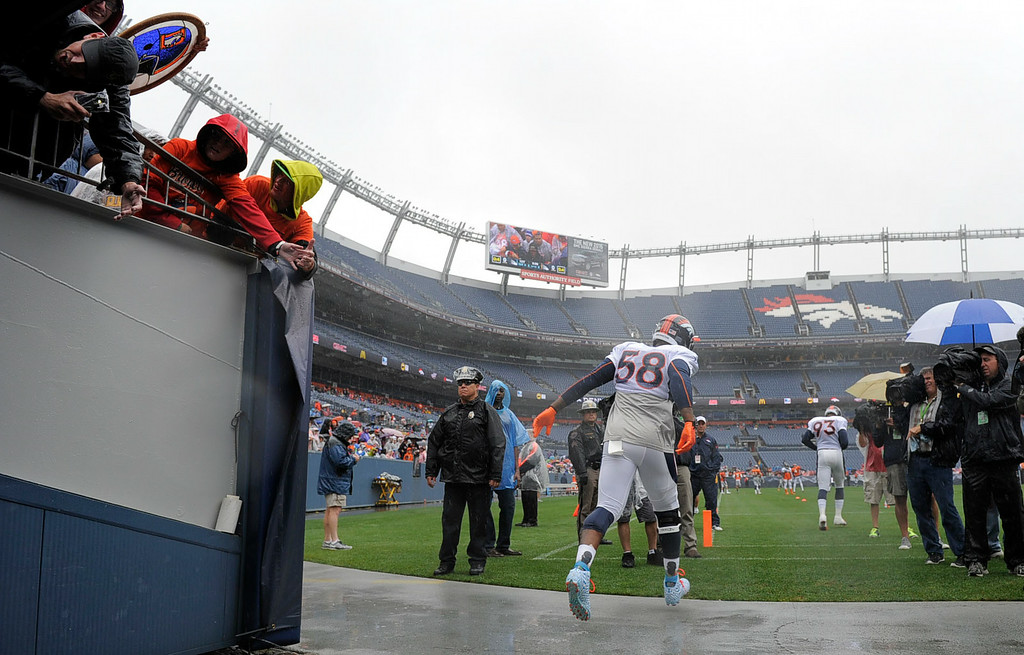 . Denver Broncos outside linebacker Von Miller (58) takes to the field during day six of the  Denver Broncos 2014 training camp July 30, 2014 at Sports Authority Field at Mile High Stadium.  (Photo by John Leyba/The Denver Post)