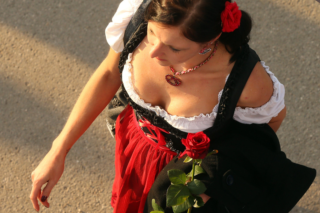 . A woman dressed in traditional Bavarian clothing `Dirndl`during day 1 of the Oktoberfest 2013 beer festival at Theresienwiese on September 21, 2013 in Munich, Germany. The Munich Oktoberfest, which this year will run from September 21 through October 6, is the world\'s largest beer fest and draws millions of visitors.  (Photo by Alexander Hassenstein/Getty Images)