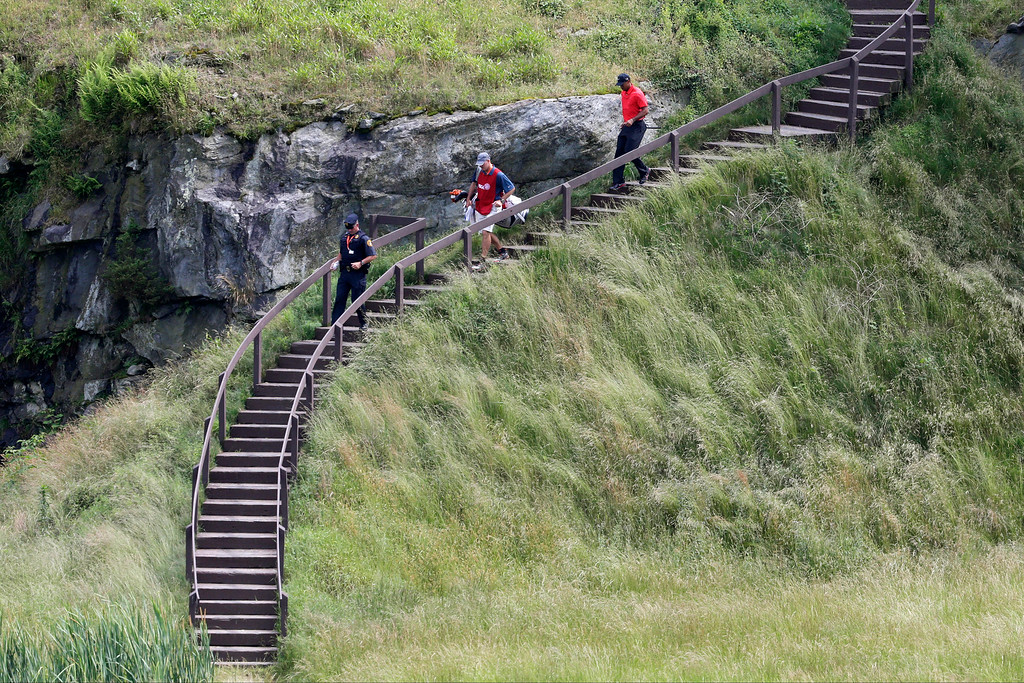. Tiger Woods, right, walks to the 17th green during the fourth round of the U.S. Open golf tournament at Merion Golf Club, Sunday, June 16, 2013, in Ardmore, Pa. (AP Photo/Gene J. Puskar)