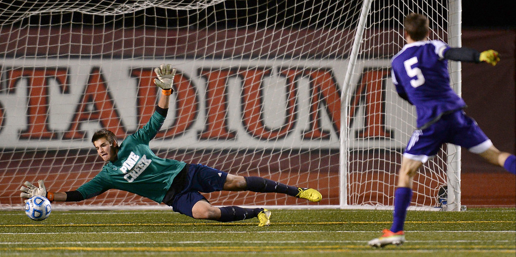 . Goalkeeper David Meyer of Pine Creek High School (1) makes a save after a kick  from Mason Douillard of Boulder High School (5) in the second half of the game at Legacy Stadium in Aurora, Colorado, on November 6, 2013. Pine Creek won 1-0 in overtime. (Photo by Hyoung Chang/The Denver Post)