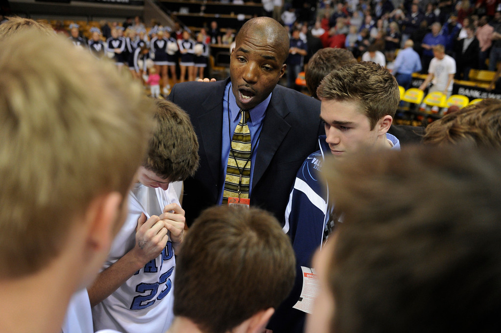 . BOULDER, CO. - MARCH 16: Valor coach Ronnie DeGray talked to the team following the loss. Lewis Palmer-High School boy\'s basketball team defeated Valor Christian 51-40 in the 4A championship game Saturday, March 16, 2013 at the Coors Events Center in Boulder.  (Photo By Karl Gehring/The Denver Post)
