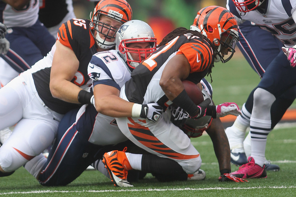 . BenJarvus Green-Ellis #42 of the Cincinnati Bengals is tackled by Joe Vellano #72 of the New England Patriots during their game at Paul Brown Stadium on October 6, 2013 in Cincinnati, Ohio.  (Photo by John Grieshop/Getty Images)