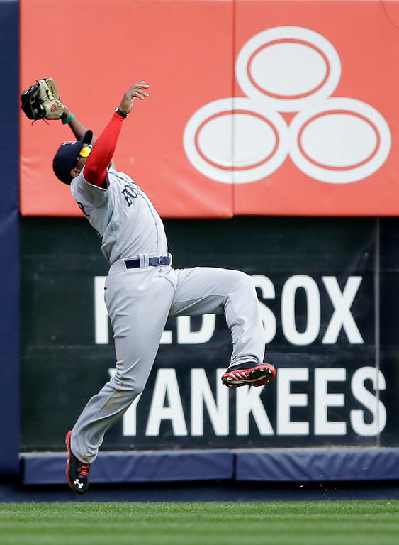 . Boston Red Sox left fielder Jackie Bradley Jr. pulls in a deep fly out by New York Yankees\' Robinson Cano during the third inning of an opening day baseball game, Monday, April 1, 2013, in New York. (AP Photo/Matt Slocum)