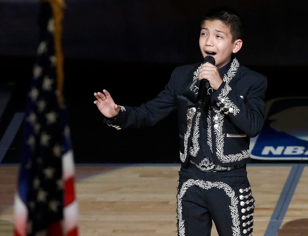 . Sebastien De la Cruz sings the U.S. National Anthem before Game 4 of the NBA Finals basketball series between the San Antonio Spurs and the Miami Heat, Thursday, June 13, 2013, in San Antonio. (AP Photo/David J. Phillip)